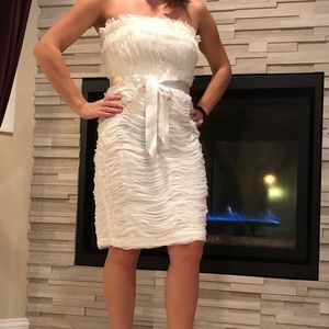 Elegant white dress for special occasions.